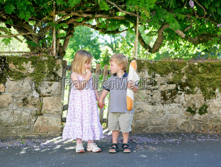 young girl and boy holding hands