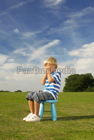 boy sitting on stool