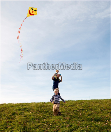 two boys and father fly a