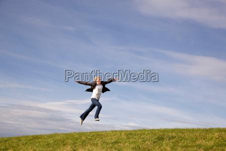 man jumping on grass