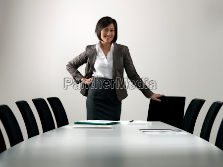 business woman by conference table