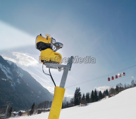 snowblower and cable car in ski