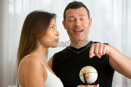 couple searching world for vacation