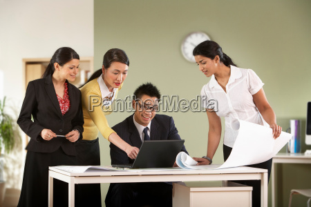 a business group discuss some plans