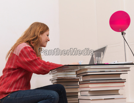 woman using laptop holding credit card