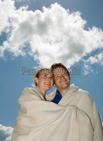 couple huddled in blanket