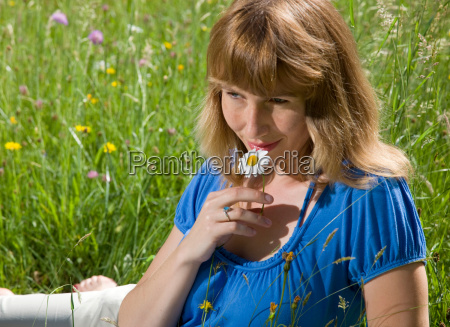 woman lying in grass with spring