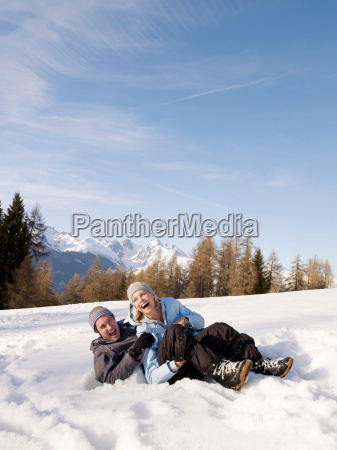 couple playing in the snow