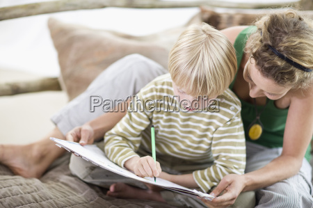mother and son are painting