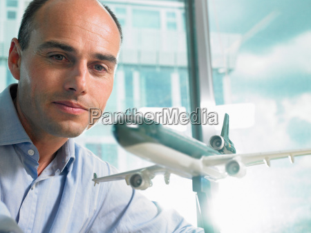 man looking at a reduced plane