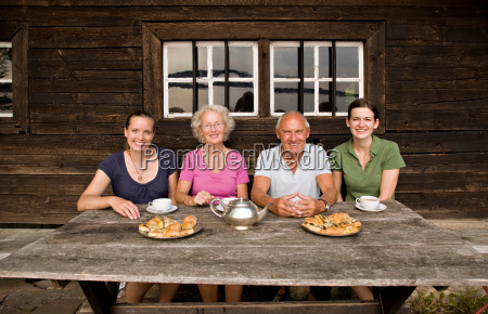 senior couple and two daughters