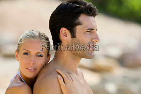 a couple embracing on the beach