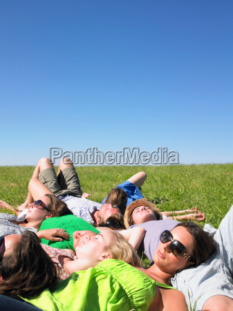 group of young people lying in