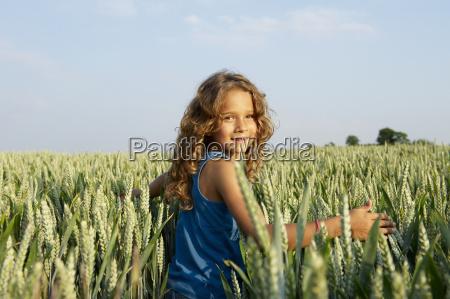girl walking in a wheat field