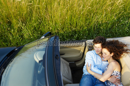 couple laying in a convertible