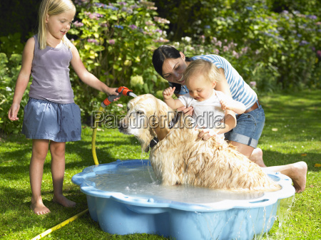 mother daughter and son washing the