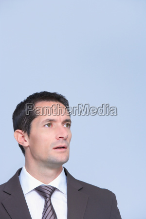 business man portrait looking amazed