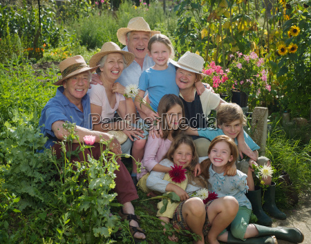 a group portrait in a garden