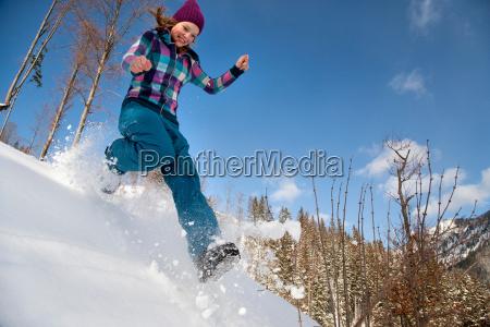 girl jumping running in snow