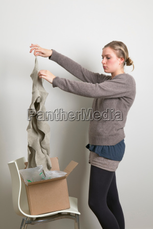 woman taking scarf out of box