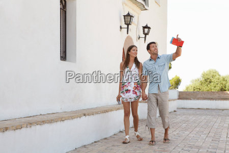 couple looking at tourist attractions