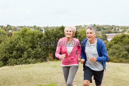 mature couple running in park