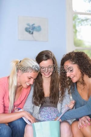 young women look in shopping bag