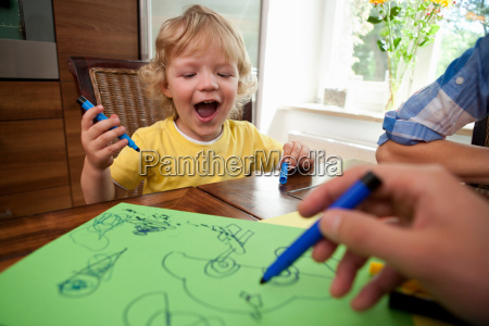 boy painting on table