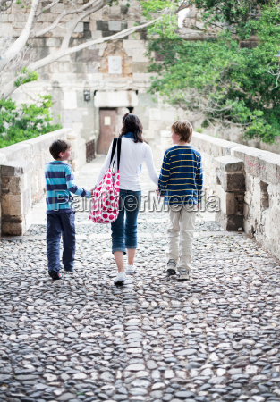 mother walking with two boys