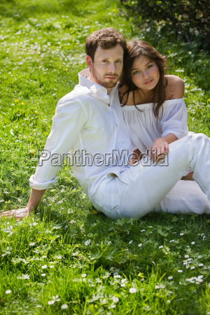 a couple sitting in the park