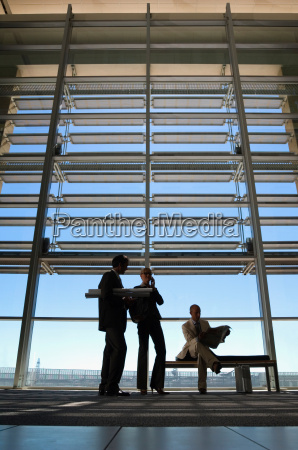 silhouette of business people in a