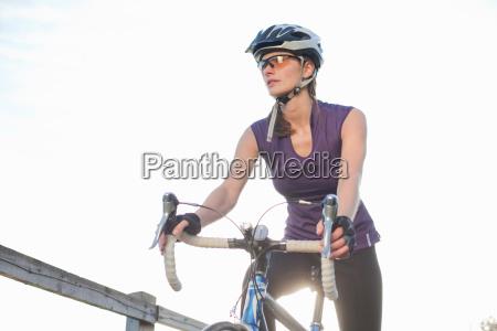 woman riding a road bike