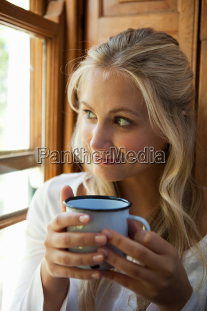 woman having cup of coffee by