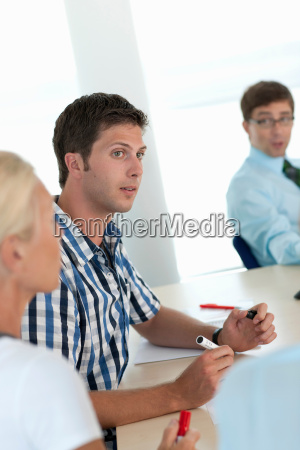 businessman making notes in conference