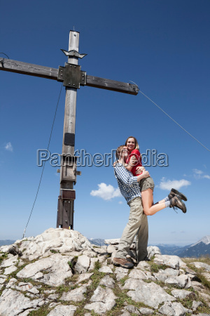 couple hugging on rocky hilltop