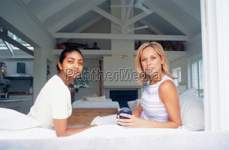 women relaxing in living room