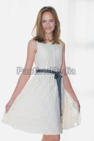 smiling girl wearing elegant dress