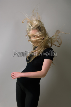 teenage, girl?s, hair, blowing, in, wind - 18209778