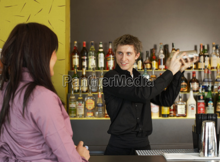 young woman talking to barman