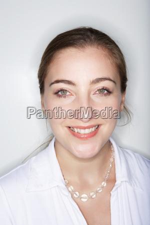 woman looking at camera smiling