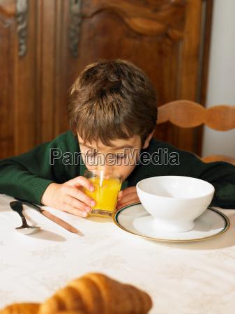 boy drinking orange juice at break