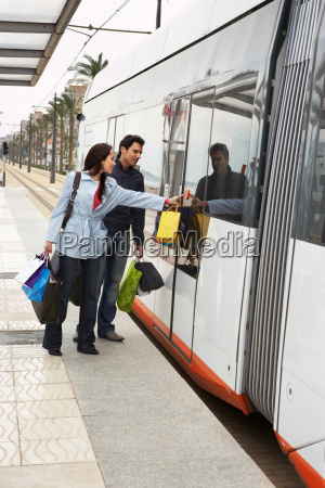 young couple holding shopping