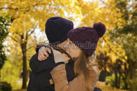 young couple hugging in autumn park