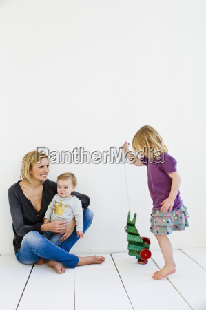 studio shot of mother and two