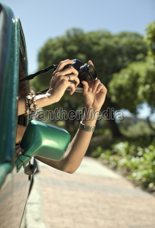 cropped image of young woman photographing
