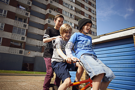 boy giving two friends a ride