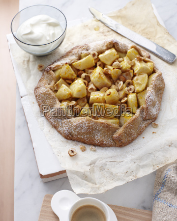 still life of pear and hazelnut