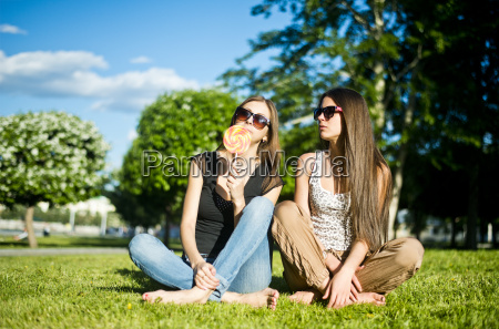 two young female friends in park