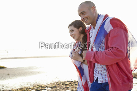 couple wrapped in british flag strolling