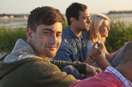 four adult friends sitting on bournemouth